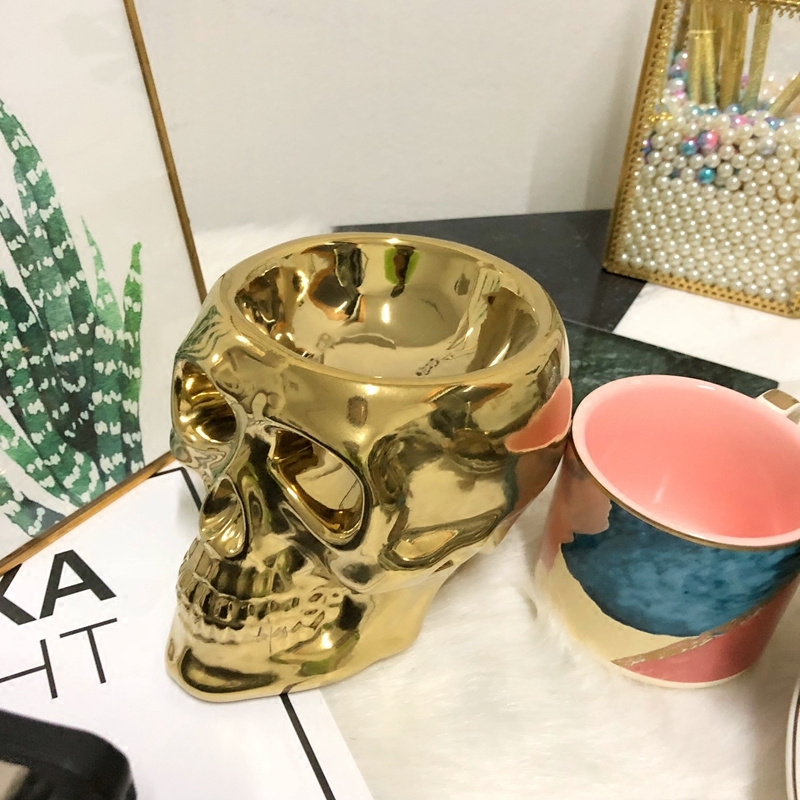 gold skull tealight candle holder